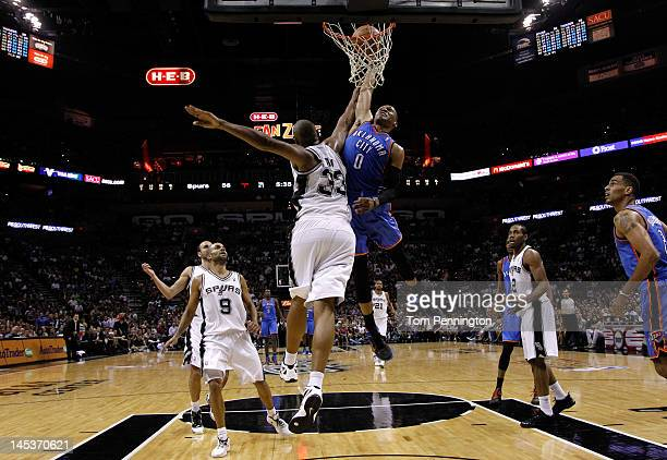 Russell Westbrook of the Oklahoma City Thunder goes up for a dunk over Boris Diaw of the San Antonio Spurs in the second half in Game One of the...