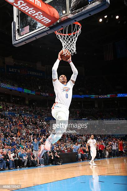 Russell Westbrook of the Oklahoma City Thunder goes up for a dunk against the Houston Rockets on April 5 2015 at Chesapeake Energy Arena in Oklahoma...