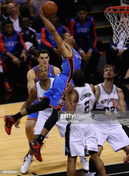 Russell Westbrook of the Oklahoma City Thunder goes up for a dunk against Kawhi Leonard of the San Antonio Spurs in the first quarter during Game...