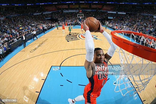 Russell Westbrook of the Oklahoma City Thunder goes up for a dunk against the Boston Celtics on December 11 2016 at Chesapeake Energy Arena in...