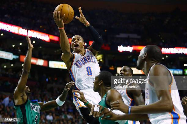 Russell Westbrook of the Oklahoma City Thunder goes up for a layup against the Boston Celtics during the game on November 23 2012 at TD Garden in...