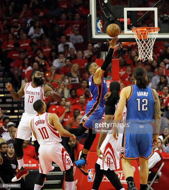 Russell Westbrook of the Oklahoma City Thunder goes up for a layup defended by Nene Hilario of the Houston Rockets and James Harden in the first half...