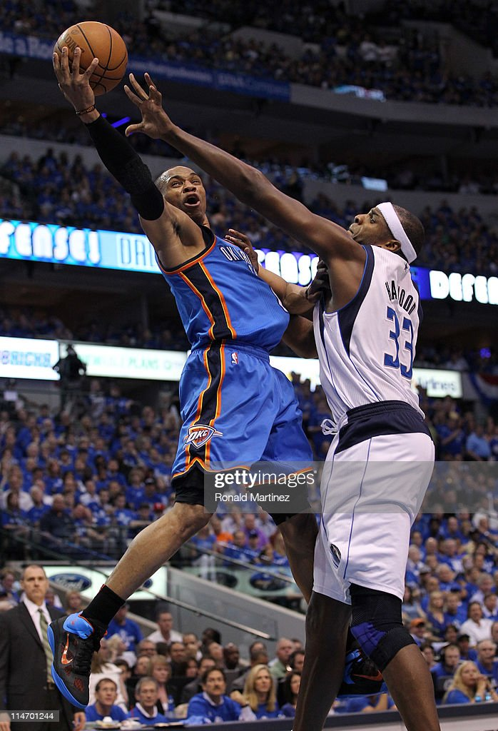 <a gi-track='captionPersonalityLinkClicked' href=/galleries/search?phrase=Russell+Westbrook&family=editorial&specificpeople=4044231 ng-click='$event.stopPropagation()'>Russell Westbrook</a> #0 of the Oklahoma City Thunder goes up for a shot against <a gi-track='captionPersonalityLinkClicked' href=/galleries/search?phrase=Brendan+Haywood&family=editorial&specificpeople=202010 ng-click='$event.stopPropagation()'>Brendan Haywood</a> #33 of the Dallas Mavericks in the second half in Game Five of the Western Conference Finals during the 2011 NBA Playoffs at American Airlines Center on May 25, 2011 in Dallas, Texas.