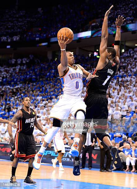 Russell Westbrook of the Oklahoma City Thunder goes up for a shot against Chris Bosh of the Miami Heat in the second quarter in Game Two of the 2012...