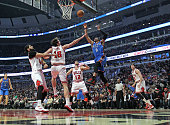 Russell Westbrook of the Oklahoma City Thunder goes up for a shot over Nikola Mirotic Pau Gasol and Kirk Hinrich of the Chicago Bulls at the United...