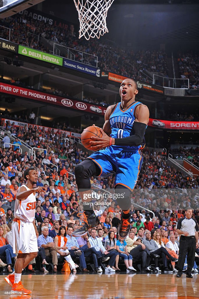 Russell Westbrook #0 of the Oklahoma City Thunder goes up for a shot against the Phoenix Suns on April 6, 2014 at U.S. Airways Center in Phoenix, Arizona.