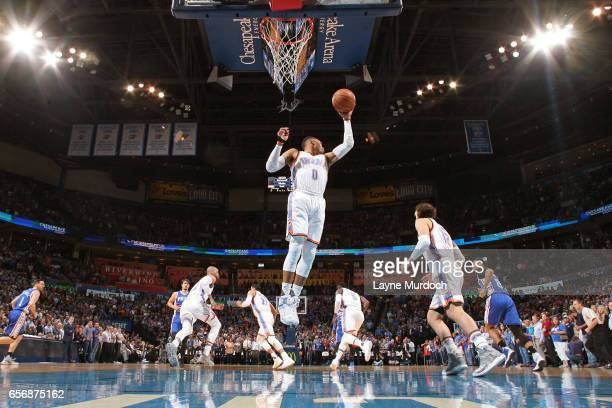 Russell Westbrook of the Oklahoma City Thunder grabs a rebound en route to the first ever perfect triple double in NBA history during the game...