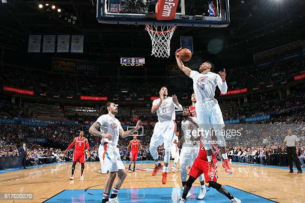 Russell Westbrook of the Oklahoma City Thunder grabs the rebound against the Houston Rockets on March 22 2016 at Chesapeake Energy Arena in Oklahoma...