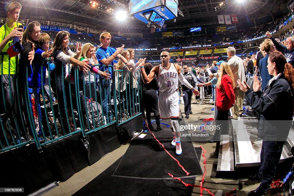 <a gi-track='captionPersonalityLinkClicked' href=/galleries/search?phrase=Russell+Westbrook&family=editorial&specificpeople=4044231 ng-click='$event.stopPropagation()'>Russell Westbrook</a> #0 of the Oklahoma City Thunder greets fans following his team's overtime victory against the Dallas Mavericks on December 27, 2012 at the Chesapeake Energy Arena in Oklahoma City, Oklahoma.
