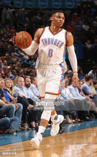 Russell Westbrook of the Oklahoma City Thunder handles the ball en route to the first ever perfect triple double in NBA history against the...