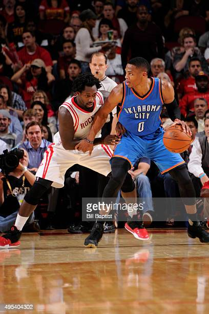 Russell Westbrook of the Oklahoma City Thunder handles the ball against Patrick Beverley of the Houston Rockets on November 2 2015 at the Toyota...