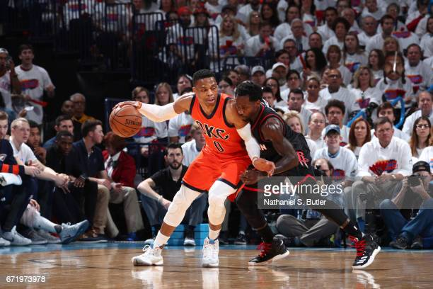 Russell Westbrook of the Oklahoma City Thunder handles the ball against Patrick Beverley of the Houston Rockets during Game Four of the Western...