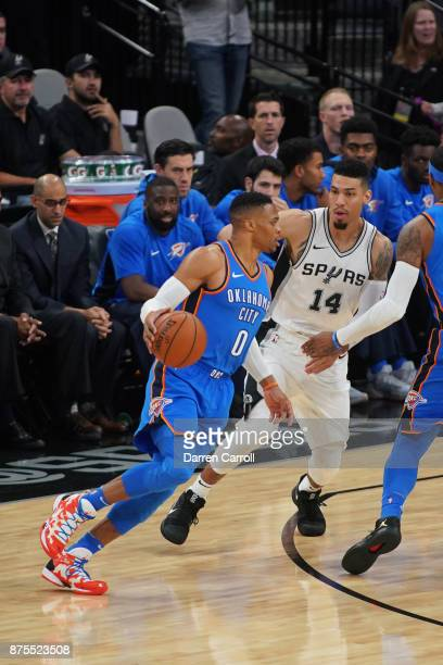 Russell Westbrook of the Oklahoma City Thunder handles the ball against Danny Green of the San Antonio Spurs on November 17 2017 at the ATT Center in...