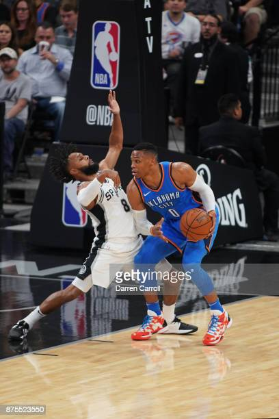 Russell Westbrook of the Oklahoma City Thunder handles the ball against Patty Mills of the San Antonio Spurs on November 17 2017 at the ATT Center in...