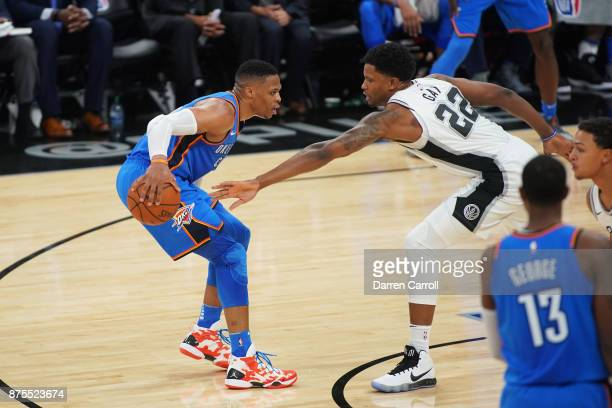 Russell Westbrook of the Oklahoma City Thunder handles the ball against Rudy Gay of the San Antonio Spurs on November 17 2017 at the ATT Center in...