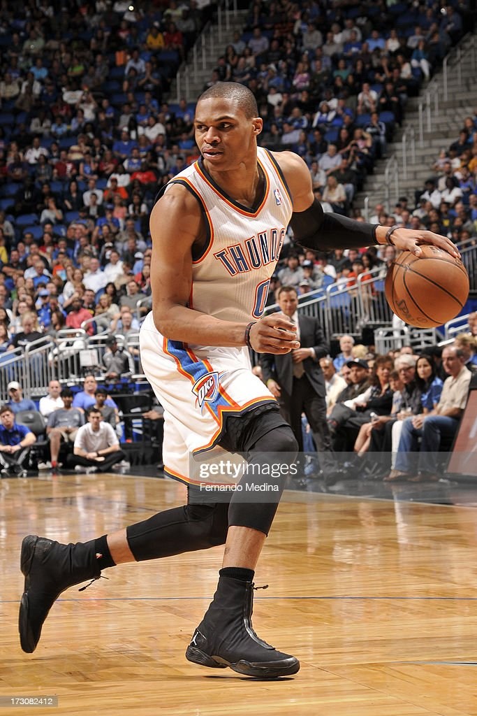 Russell Westbrook #0 of the Oklahoma City Thunder handles the ball against the Orlando Magic on March 22, 2013 at Amway Center in Orlando, Florida.