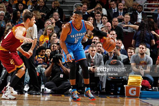 Russell Westbrook of the Oklahoma City Thunder handles the ball against the Cleveland Cavaliers on December 17 2015 at Quicken Loans Arena in...