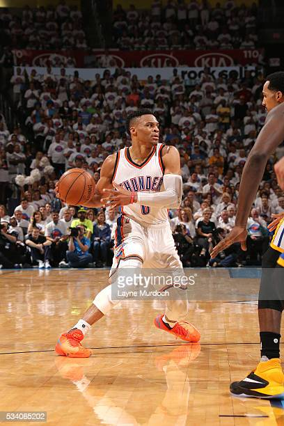 Russell Westbrook of the Oklahoma City Thunder handles the ball during the game tate Warriors in Game Four of the Western Conference Finals during...