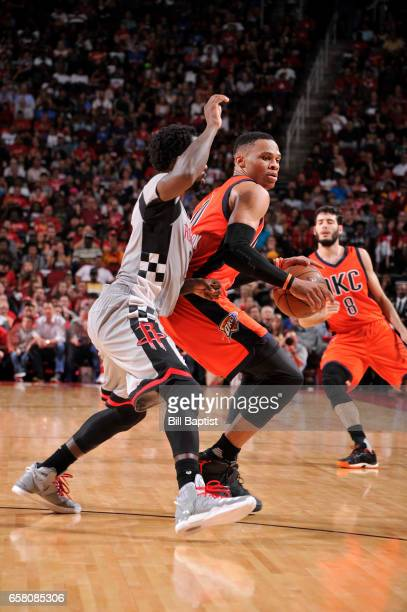 Russell Westbrook of the Oklahoma City Thunder handles the ball against the Houston Rockets during the game on March 26 2017 at the Toyota Center in...