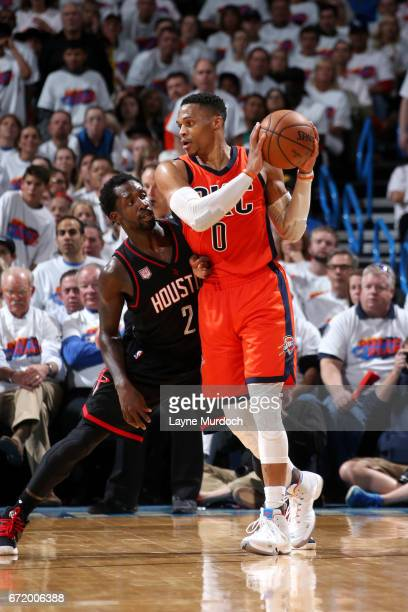 Russell Westbrook of the Oklahoma City Thunder handles the ball during the game against Patrick Beverley of the Houston Rockets in Game Four during...