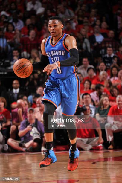 Russell Westbrook of the Oklahoma City Thunder handles the ball against the Houston Rockets in Game Five of the Western Conference Quarterfinals of...