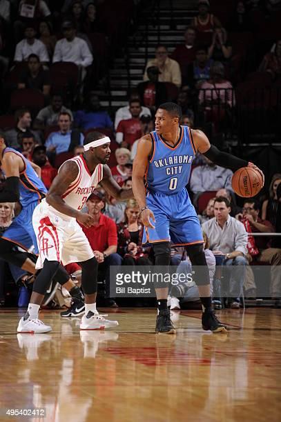 Russell Westbrook of the Oklahoma City Thunder handles the ball against Ty Lawson of the Houston Rockets on November 2 2015 at the Toyota Center in...