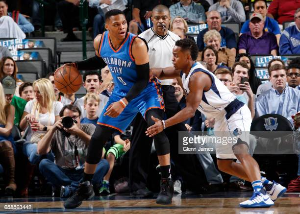 Russell Westbrook of the Oklahoma City Thunder handles the ball against Yogi Ferrell of the Dallas Mavericks during a game on March 27 2017 at...