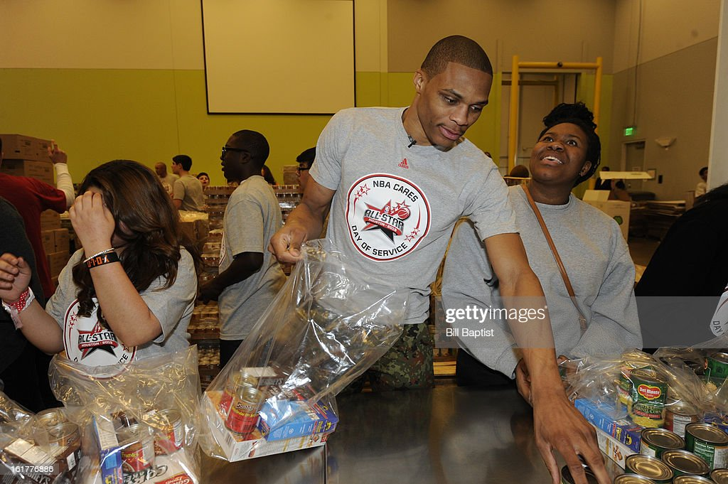 Russell Westbrook #0 of the Oklahoma City Thunder helps out with food at the 2013 NBA Cares Day of Service at the Food Bank sorting on February 15, 2013 in Houston, Texas.