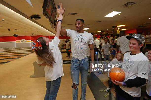 Russell Westbrook of the Oklahoma City Thunder high fives fans during his 7th annual Why Not Foundation bowling event on March 24 2017 at the AMF...
