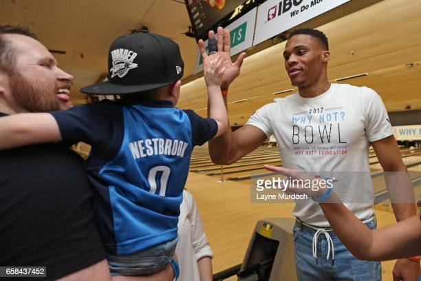 Russell Westbrook of the Oklahoma City Thunder high fives kids during his 7th annual Why Not Foundation bowling event on March 24 2017 at the AMF...