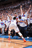 Russell Westbrook of the Oklahoma City Thunder hits a shot and turns around to shake his brother Ray Westbrook's hand in the stands during Game Four...