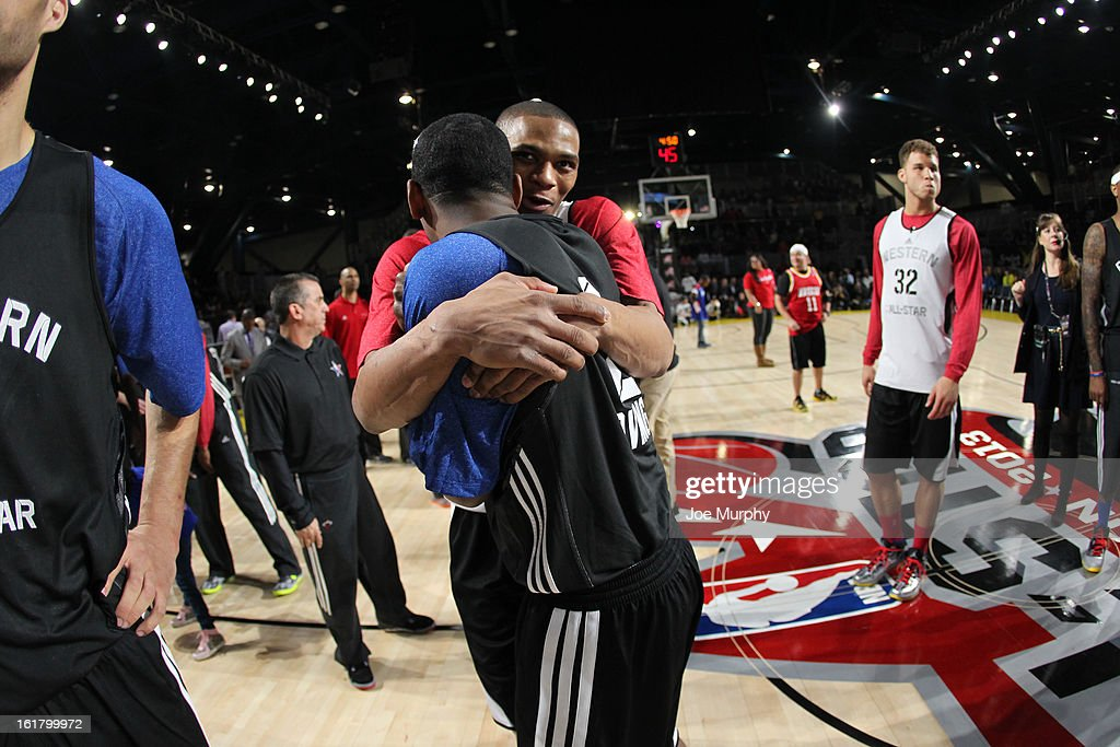 Russell Westbrook #0 of the Oklahoma City Thunder hugs Kyrie Irving #2 of the Cleveland Cavaliers during the NBA All-Star Practice in Sprint Arena during the 2013 NBA All-Star Weekend on February 16, 2013 at the George R. Brown Convention Center in Houston, Texas.