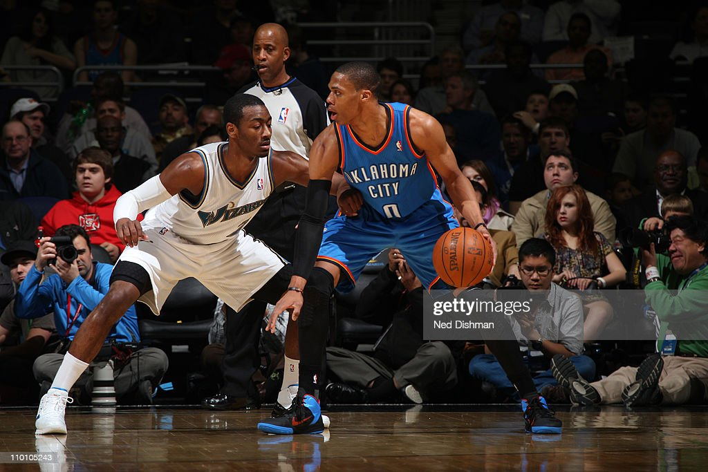 <a gi-track='captionPersonalityLinkClicked' href=/galleries/search?phrase=Russell+Westbrook&family=editorial&specificpeople=4044231 ng-click='$event.stopPropagation()'>Russell Westbrook</a> #0 of the Oklahoma City Thunder in action against <a gi-track='captionPersonalityLinkClicked' href=/galleries/search?phrase=John+Wall&family=editorial&specificpeople=2265812 ng-click='$event.stopPropagation()'>John Wall</a> #2 of the Washington Wizards on March 14, 2011 at the Verizon Center in Washington, DC.