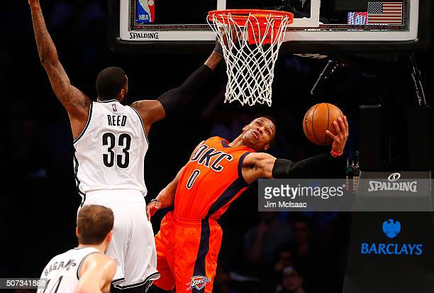 Russell Westbrook of the Oklahoma City Thunder in action against Willie Reed of the Brooklyn Nets at Barclays Center on January 24 2016 in the...