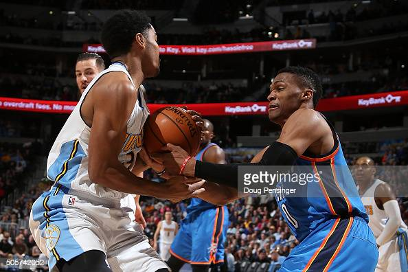 Russell Westbrook of the Oklahoma City Thunder is called for a foul as he battles Gary Harris of the Denver Nuggets for the ball at Pepsi Center on...