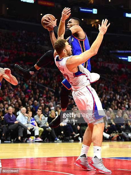 Russell Westbrook of the Oklahoma City Thunder is fouled on a drive by Blake Griffin of the Los Angeles Clippers during the first half at Staples...
