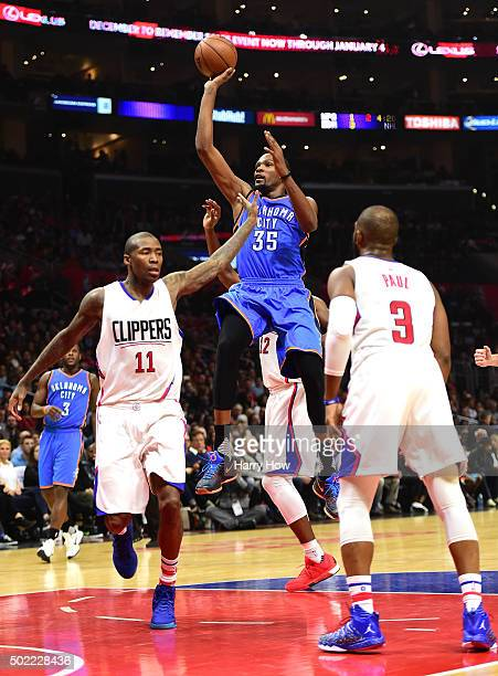 Russell Westbrook of the Oklahoma City Thunder is fouled on his shot by Jamal Crawford of the Los Angeles Clippers as Chris Paul looks on during the...