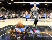 Russell Westbrook of the Oklahoma City Thunder is tripped from behind by Danny Green of the San Antonio Spurs at ATT Center on March 12 2016 in San...