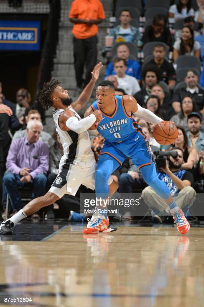 Russell Westbrook of the Oklahoma City Thunder jocks for a position against the San Antonio Spurs on November 17 2017 at the ATT Center in San...