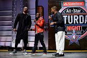 Russell Westbrook of the Oklahoma City Thunder joins comedians Kevin Hart and Anthony Anderson on stage during the Foot Locker Three Point Contest on...