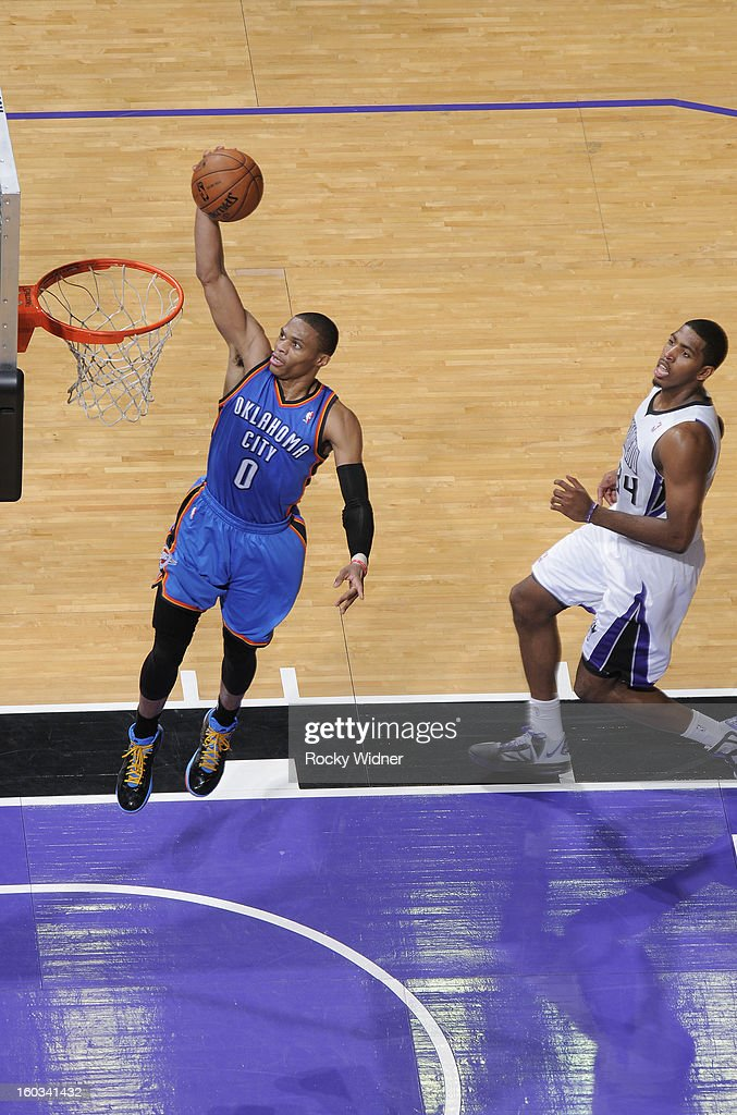 <a gi-track='captionPersonalityLinkClicked' href=/galleries/search?phrase=Russell+Westbrook&family=editorial&specificpeople=4044231 ng-click='$event.stopPropagation()'>Russell Westbrook</a> #0 of the Oklahoma City Thunder lays the ball in against Jason Thompson #34 of the Sacramento Kings on January 25, 2013 at Sleep Train Arena in Sacramento, California.