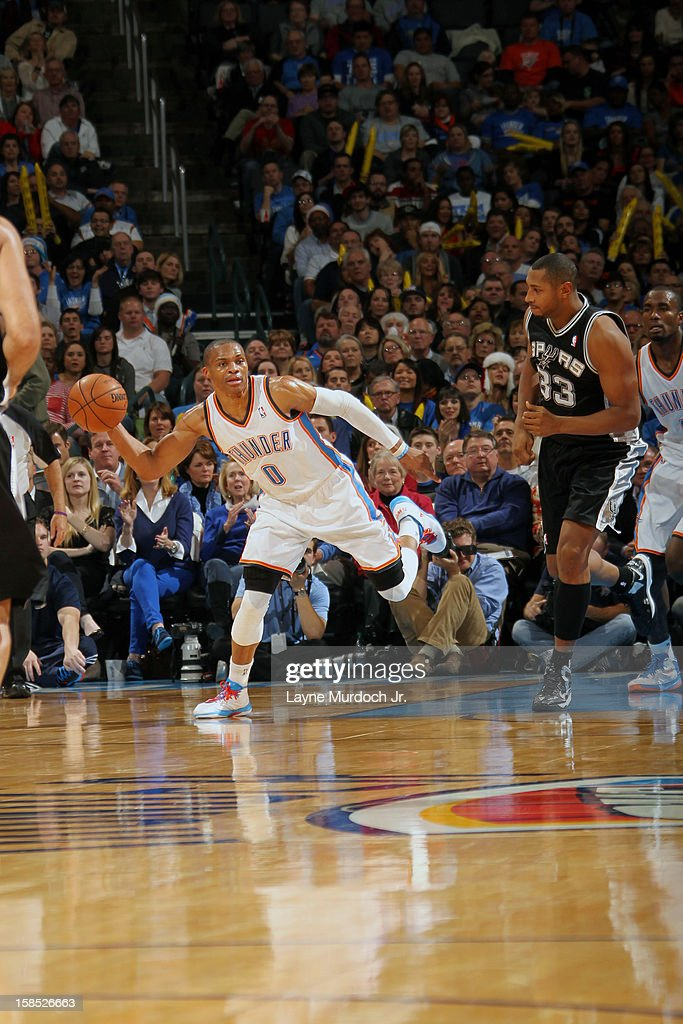 <a gi-track='captionPersonalityLinkClicked' href=/galleries/search?phrase=Russell+Westbrook&family=editorial&specificpeople=4044231 ng-click='$event.stopPropagation()'>Russell Westbrook</a> #0 of the Oklahoma City Thunder looks down court to pass the ball against the San Antonio Spurs during an NBA game on December 17, 2012 at the Chesapeake Energy Arena in Oklahoma City, Oklahoma.
