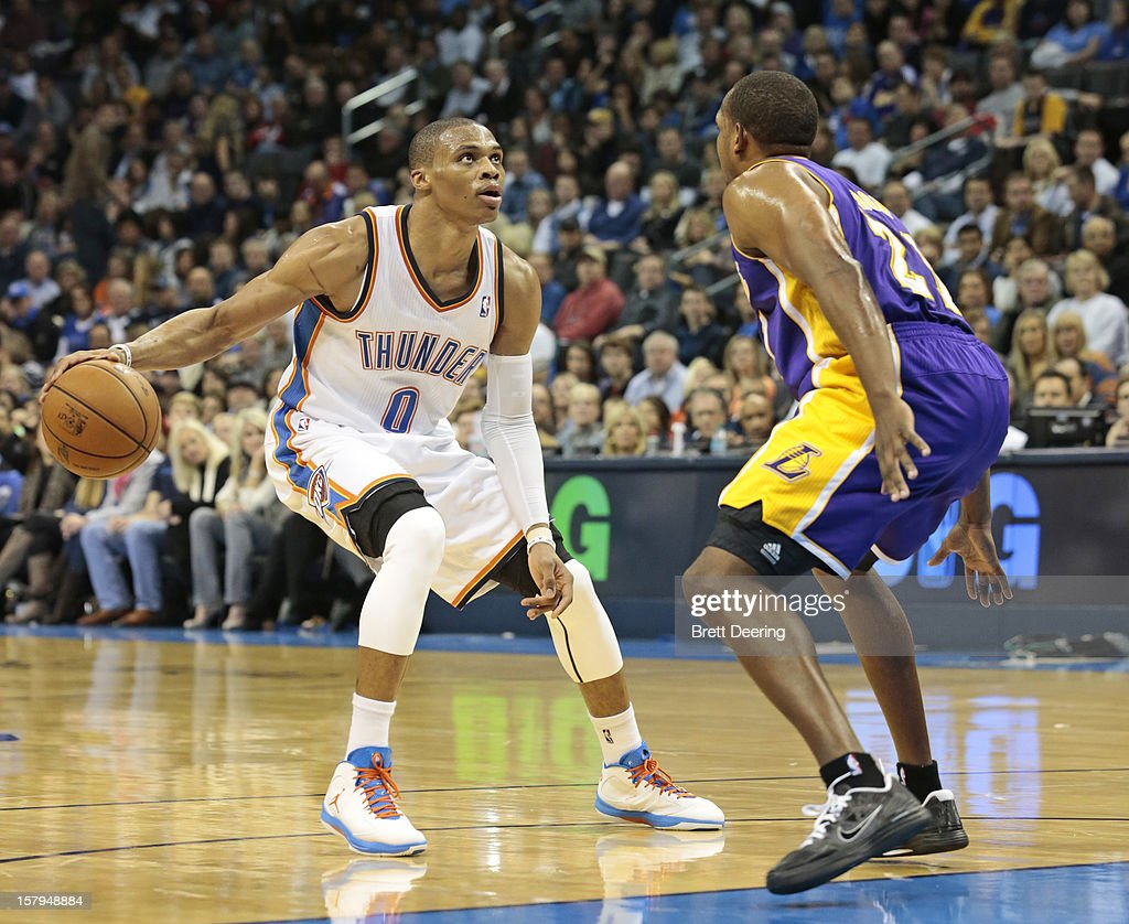 <a gi-track='captionPersonalityLinkClicked' href=/galleries/search?phrase=Russell+Westbrook&family=editorial&specificpeople=4044231 ng-click='$event.stopPropagation()'>Russell Westbrook</a> #0 of the Oklahoma City Thunder looks inside as <a gi-track='captionPersonalityLinkClicked' href=/galleries/search?phrase=Chris+Duhon&family=editorial&specificpeople=202879 ng-click='$event.stopPropagation()'>Chris Duhon</a> #21 of the Los Angeles Lakers defends December 7, 2012 at Chesapeake Energy Arena in Oklahoma City, Oklahoma. Oklahoma City defeated Los Angeles 114-108.