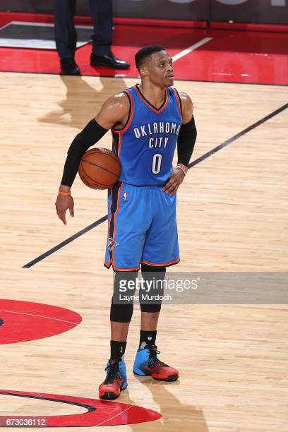 Russell Westbrook of the Oklahoma City Thunder looks on during the game against the Houston Rockets in Game Five of the Western Conference...