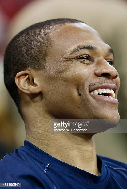 Russell Westbrook of the Oklahoma City Thunder looks on from the bench during warm ups prior to the game against Sacramento Kings at Sleep Train...