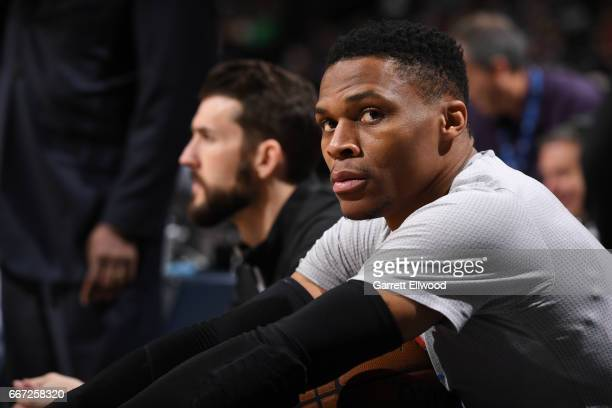 Russell Westbrook of the Oklahoma City Thunder looks on from the bench before the game against the Denver Nuggets on April 9 2017 at the Pepsi Center...