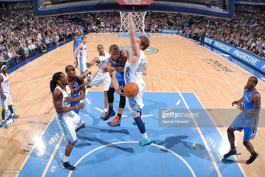 <a gi-track='captionPersonalityLinkClicked' href=/galleries/search?phrase=Russell+Westbrook&family=editorial&specificpeople=4044231 ng-click='$event.stopPropagation()'>Russell Westbrook</a> #0 of the Oklahoma City Thunder looks to pass around the back of <a gi-track='captionPersonalityLinkClicked' href=/galleries/search?phrase=Timofey+Mozgov&family=editorial&specificpeople=3949705 ng-click='$event.stopPropagation()'>Timofey Mozgov</a> #25 of the Denver Nuggets on March 15, 2012 at the Pepsi Center in Denver, Colorado.
