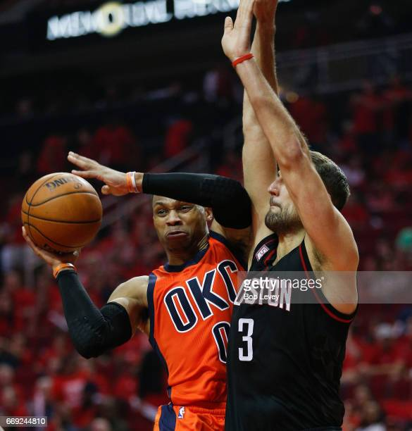 Russell Westbrook of the Oklahoma City Thunder looks to pass as Ryan Anderson of the Houston Rockets defends during Game One of the first round of...