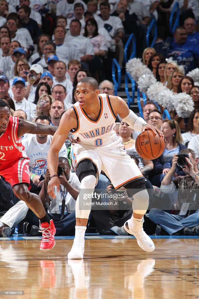 <a gi-track='captionPersonalityLinkClicked' href=/galleries/search?phrase=Russell+Westbrook&family=editorial&specificpeople=4044231 ng-click='$event.stopPropagation()'>Russell Westbrook</a> #0 of the Oklahoma City Thunder looks to pass the ball against the Houston Rockets in Game Two of the Western Conference Quarter Finals during the 2013 NBA playoffs on April 24, 2013 at the Chesapeake Energy Arena in Oklahoma City, Oklahoma.