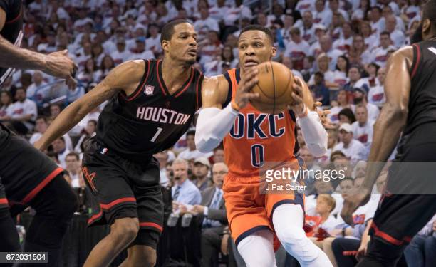 Russell Westbrook of the Oklahoma City Thunder looks to pass the ball as Trevor Ariza of the Houston Rockets applies pressure during the second half...